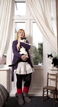 Eight lives: Louis, left, and Gizmo have fallen from Charlotte Rudolph's flat