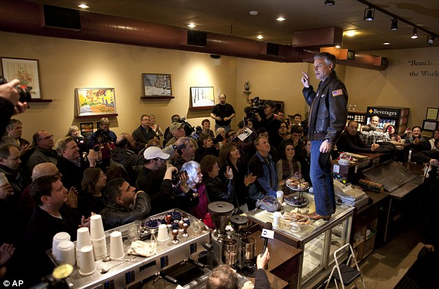 Making a stand: Former Utah Governor Jon Huntsman makes himself heard from a counter top at Bean Towne Coffee House in Hampstead, New Hampshire