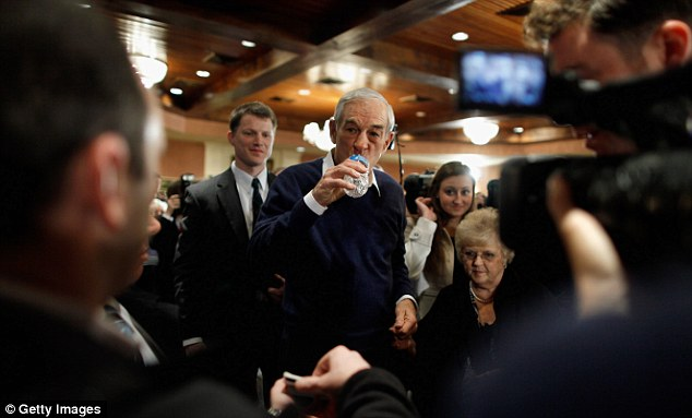 Thirsty work: Ron Paul gets a quick drink of water at a campaign town hall meeting at the Church Landing in Meredith, New Hampshire last night