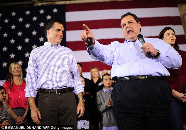 Tough talk: Republican hopeful Mitt Romney receives the endorsement of New Jersey Governor Chris Christie (right) during a rally in New Hampshire - where they were interrupted by Occupy protesters