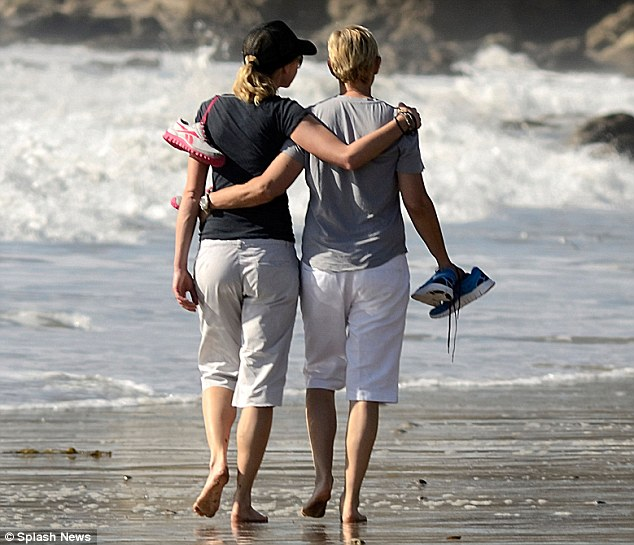 Ah, love: The married couple wrapped their arms around one another during their beach walk