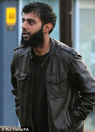 In the dock: Kabir Ahmed, 28, arrives at Derby Crown Court where, along with 4 others, he is on trial accused of stirring up hatred on the grounds of sexual orientation