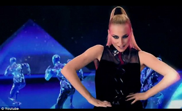 Madonna or Pixie? Lott channels the Material Girl's 1990s style in a portion of her new video for song Kiss The Stars