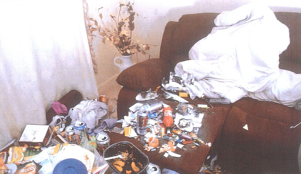Appalling: a remote control on  a reclining sofa is swamped by a dirty duvet, beer cans, lighters, cigarette papers, tobacco, ashes, crisp packets and a half-eaten microwave meal