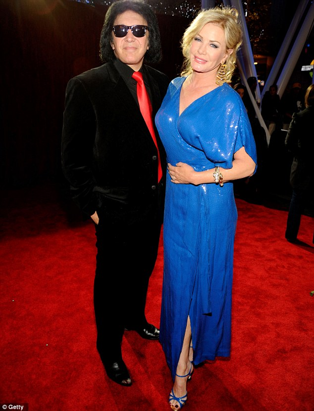 Kiss of death: No doubt rocker Gene Simmons will believe he brought some much needed rock and roll credibility to the event with wife Shannon Tweed