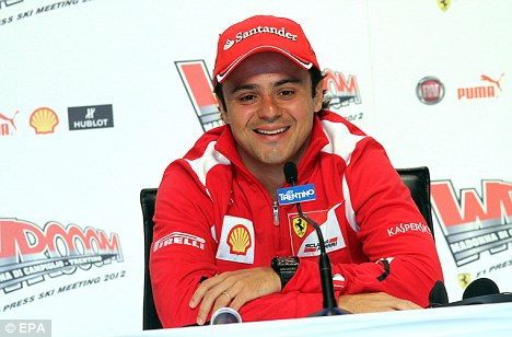All smiles: Massa speaks to reporters on Thursday