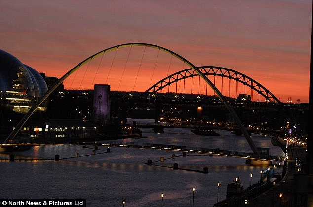 Don't blink: Commuters on their way home were treated to a spectacular winter sunset over the Newcastle city centre skyline