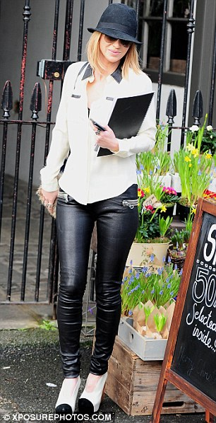 Looking lovely in leather: Sarah wore a pair of tight black trousers as she left her home this afternoon