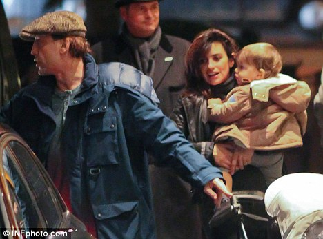 Happy families: Penelope and her husband Javier Bardem were seen arriving at a London hotel