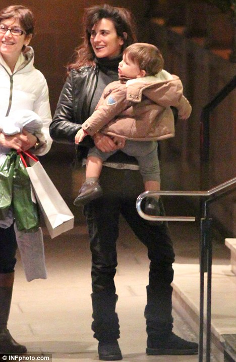 What a little jetsetter! Penelope Cruz toted her gorgeous baby boy Leo as the family arrived in London