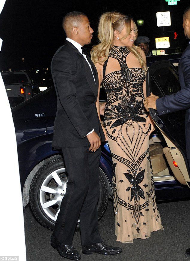 The diet works! The Jenny Craig ambassador displayed a flat tummy underneath her extravagant maxi dress