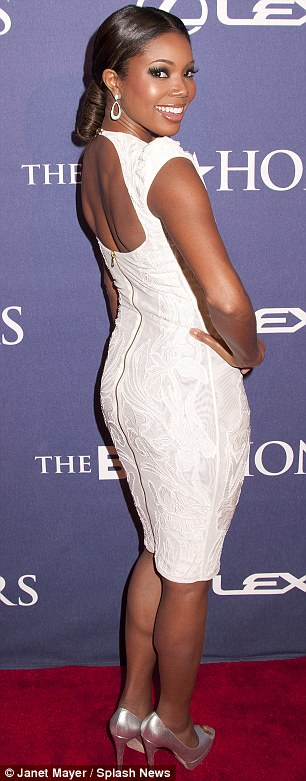 Presenting your host: Gabrielle Union look hot in white tonight and wore a show-stopper yesterday too