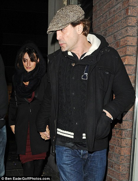 Casual in the Capital: Bardem wore trainers, a flat cap and jeans for the couple's night out at the Japanese sushi restaurant