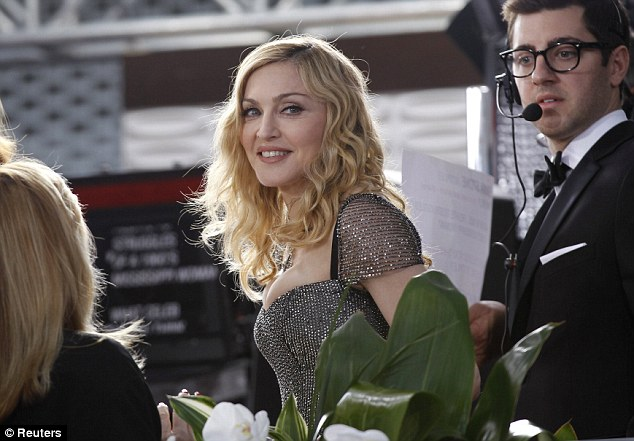 Victorious: Madonna retorted 'may the best man win' ... but walked away with the prize on the night