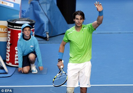 Salute: Rafael Nadal waves to the crowd after winning his first round match