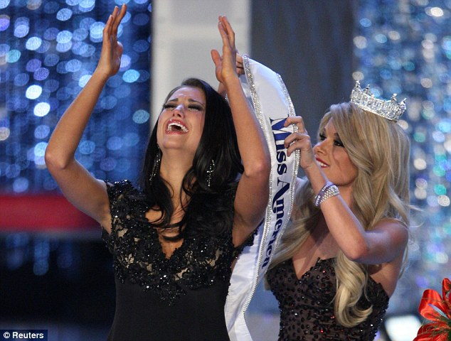 Joy: The 23-year-old is given the winners' sash by Miss America 2011 Teresa Scanlan