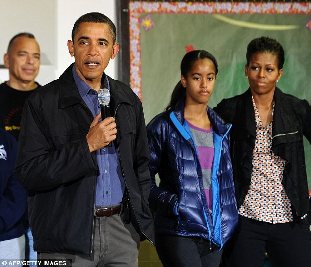 Long-winded: Even Michelle (right) looks like she wishes the President (left) would hurry up already