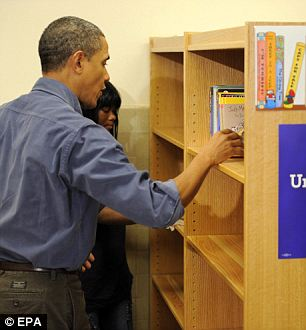 The Republicans'll have a field day: After the bookshelf was finished, the President perused through the reading material, including a book title On Leadership
