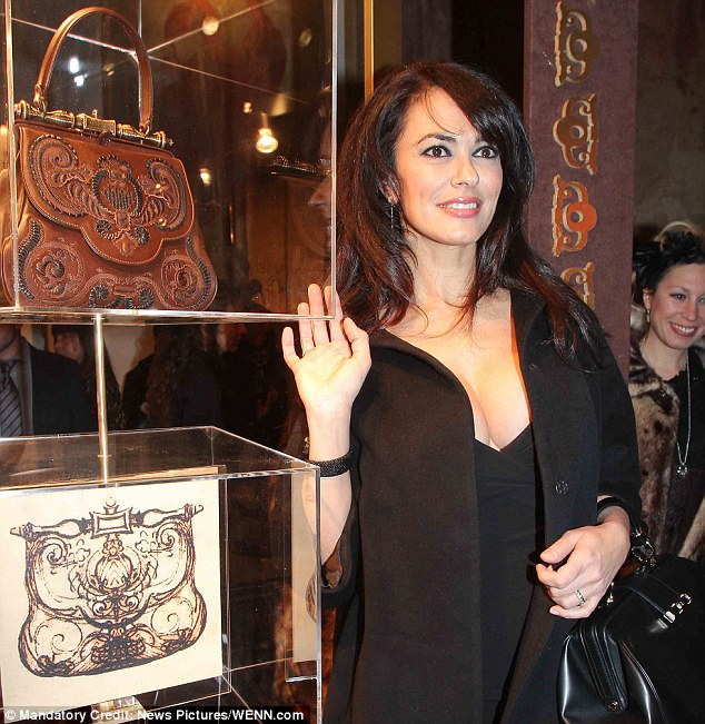 Precious: Maria Grazia Cucinotta presenting the new handbag at Gherardini's in Florence in Italy which has named it the 'Pretiosa' - meaning precious