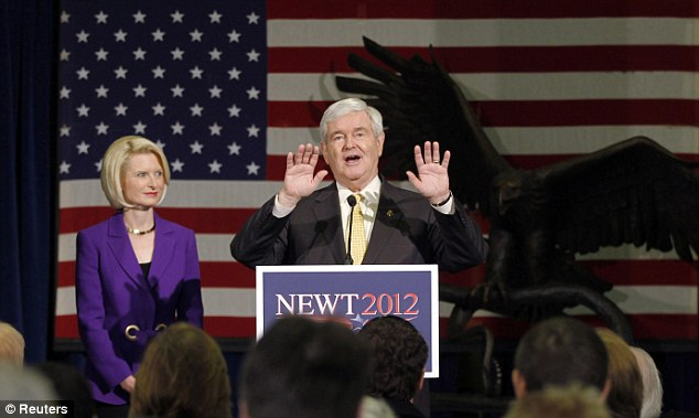 Where eagle dares: Gingrich speaks to supporters alongside his wife Callista at the Art Trails Gallery in Florence, South Carolina, yesterday