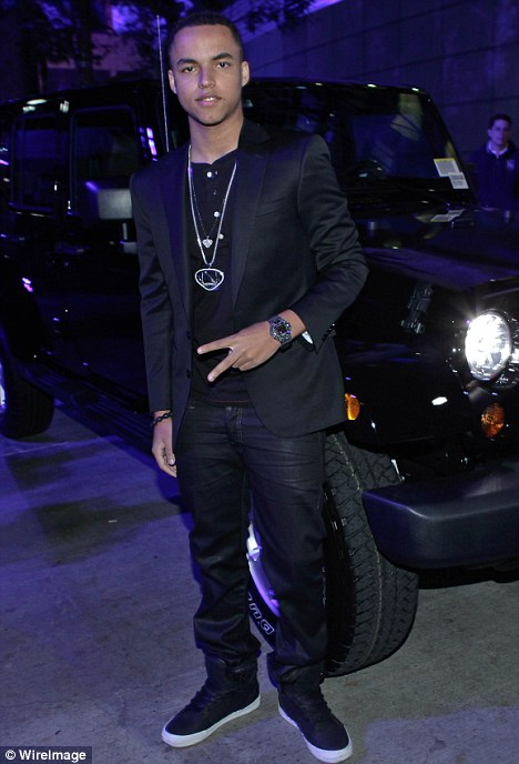 Arriving in style: Although Connor arrived at the party in a Rolls Royce Ghost, he posed up in front of Jeep