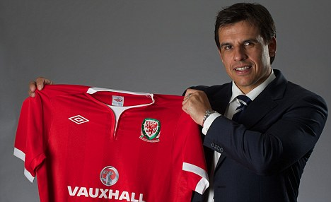 New man: Chris Coleman poses with the Wales shirt