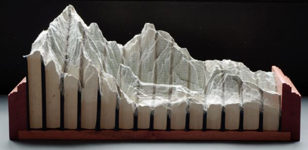 Among Mr Laramee's sculptural works are two incredible series of carved book landscapes and structures entitled Biblios and The Great Wall Laramee