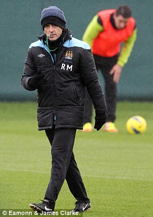 On the whistle: Mancini traded insults with Redknapp