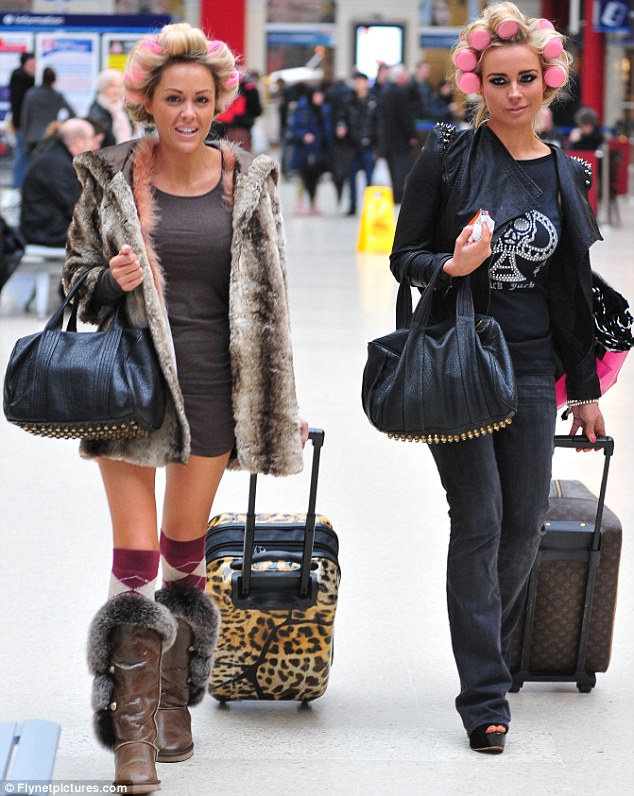 Heading South, Scouse style: Amanda Harrington and Debbie O'Toole hopped on a train from Liverpool to London earlier today wearing pink rollers in their hair