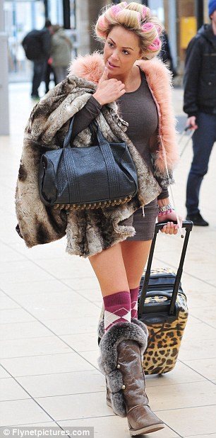 Fashion miss: Debbie wore an odd melange of fur and leather boots, pink checked socks and a furry peach gilet for the journey