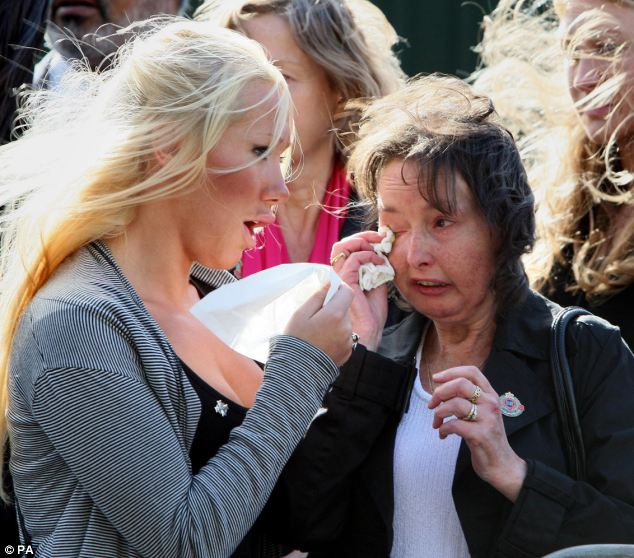 Jaime Quinsey, the sister of dead soldier Mark Quinsey, comforting her mother Pamela, as Mark's comrades make an emotional return to their Northern Ireland barracks after a six-month tour of Afghanistan in 2009