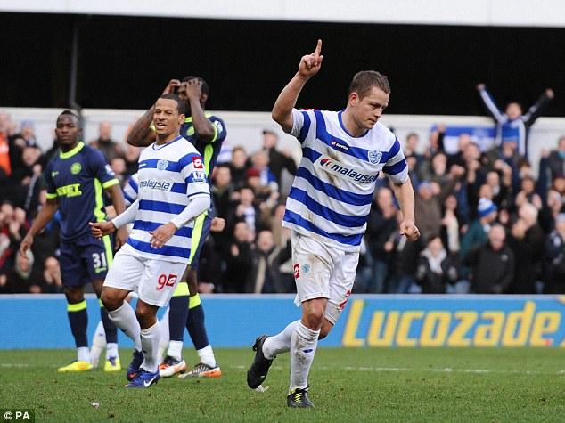 Queens Park Rangers' Heidar Helguson celebrates scoring his
