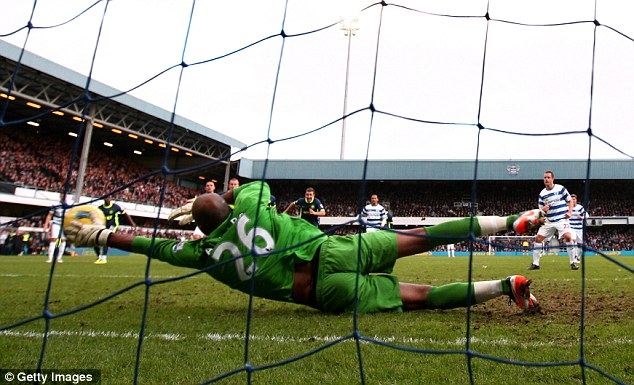 Heidar Helguson of QPR scores the opening goal from the penalty spot  past goalkeeper Ali Al-Habsi #26 of Wigan