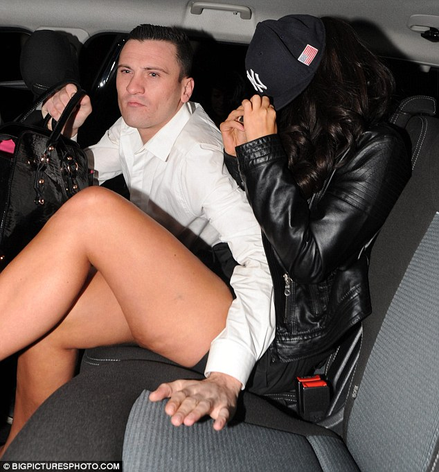Had enough? By the end of the night Tulisa was covering her bleary face and flashing even more leg
