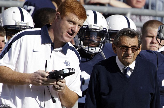 Paterno pictured with Penn State assistant coach Mike McQueary, who allegedly witnessed Sandusky carrying out a sex act with a boy