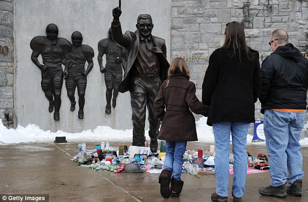 Community members pay their respects to the former Penn State football coach
