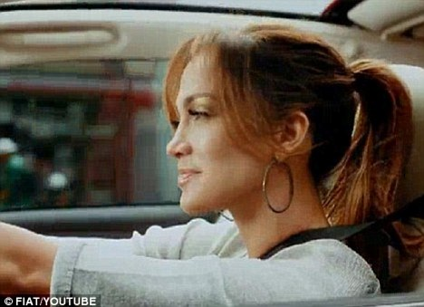 Under fire once more: Instead of travelling to her old neighbourhood the Bronx to shoot the driving scenes, JLo used a body double for her Fiat advert