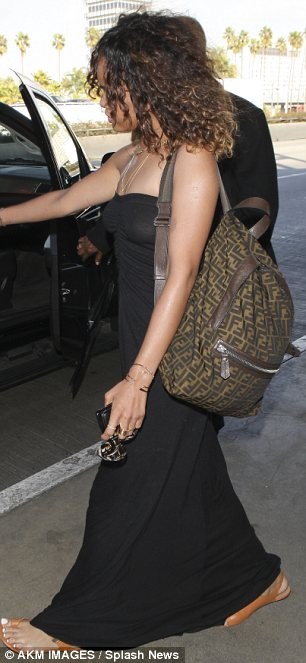 Laid back style: The singer, 23, was wearing a flowing maxi-dress and simple sandals as she arrived back into the U.S.
