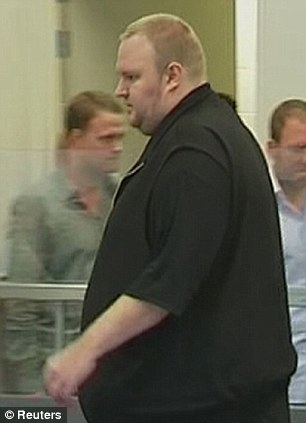 Distinctive: Dotcom's defence lawyer argued that at 6ft 6in and weighing more than 20 stone (285lbs) the former hacker was unlikely to pass unnoticed through customs and immigration