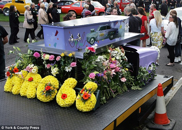 Car fan: Kasey's funeral was befitting for his love of motoring. His coffin was placed on top of a replica of his Ford Cortina