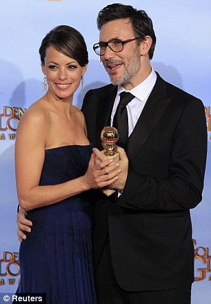 Winners: Following their Golden Globes success, Martin Scorsese and Michel Hazanavicius - pictured with his wife and leading lady Berenice Bejo, are both up for Best Director