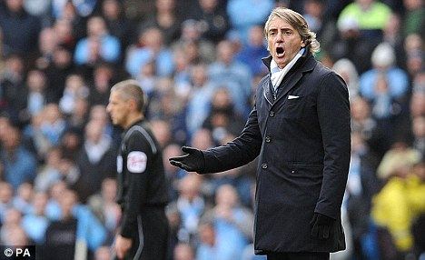 Impressed: Mancini is keen to bolster his midfield options