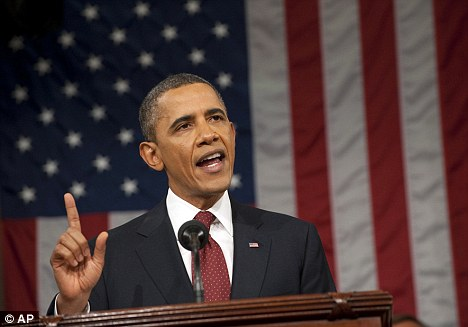 Confident: Obama delivers his State of the Union address on Capitol Hill, which was scathing of Romney