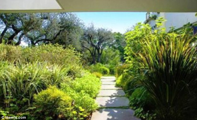 Lush: The one-acre property features a lot of lush green shrubbery