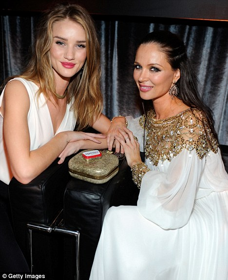 The Oscar nominations show that Harvey is back on top and to help him celebrate, his wife Georgina Chapman (pictured right with Rosie Huntington-Whiteley) will be at his side