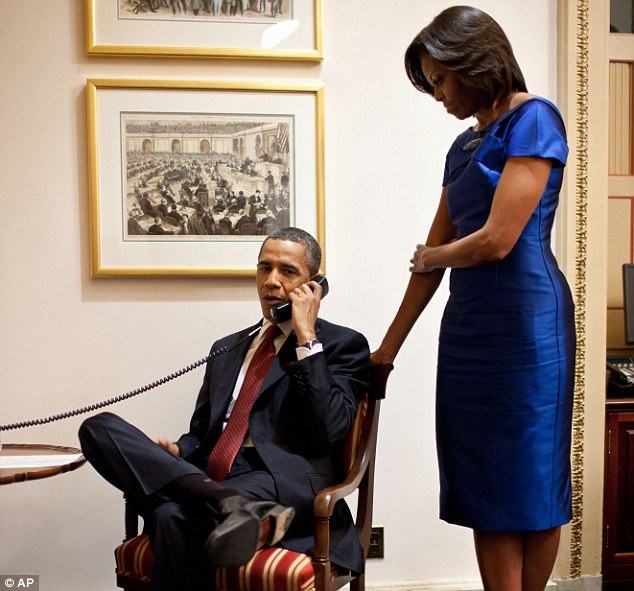 Phone call: Barack Obama, seen with wife Michelle, called Ms Buchanan's dad John to say: 'All Americans have Jessica in our thoughts and prayers, and give thanks that she will soon be reunited with her family'