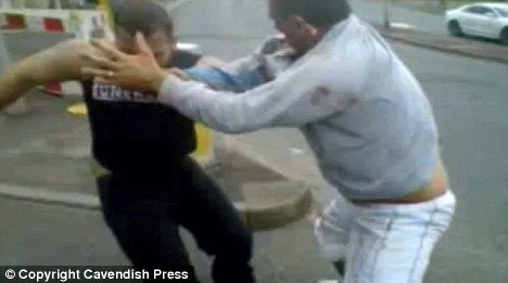 Scrap: Footage of the fight shows Doherty, right, grappling with his cousin Joyce as the gypsy family's feud boiled over in public