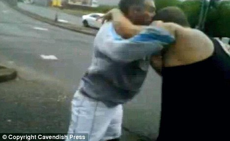 Shocking: The pair scrapped in broad daylight in front of stunned motorists outside the PC World in Manchester
