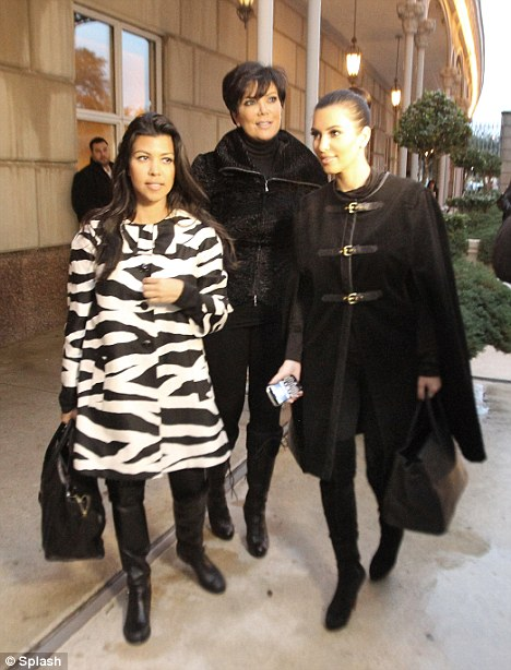 Caped crusaders: The Kardashian family all arrive to a dinner at Nobu in Dallas as they visit Khloe who recently moved to the city