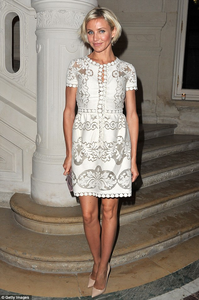 Babydoll: Cameron slipped into a girly cream lace dress to attend Valentino's show at the Hotel Salomon de Rothschild this evening